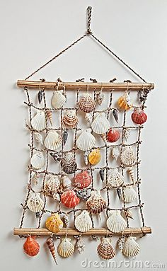 Photo about Sea shell decor - Sea shells on net on the wall. Image of decor, cord, mussel - 15107518 Seashell Art, Seashell Crafts, Beach Crafts, Fun Crafts, Diy And Crafts, Arts And Crafts, Seashell Decorations, Sea Decoration, Seashell Wind Chimes
