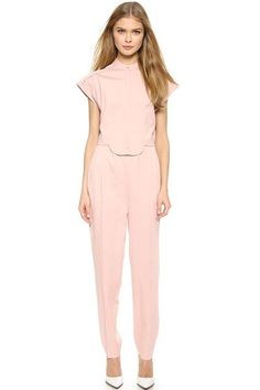 The Short-Sleeved Jumpsuit For those who prefer a more put-together vibe, a style with a structured sleeve (one that covers the shoulders and the upper part of the arm) should be your go-to. This Viktor & Rolf number mimics the buttoned-up look of a matching top and trouser, but fitted in all the right places and not obviously an adult onesie.