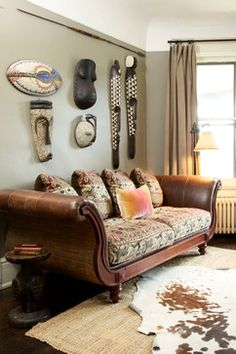 Lovely Display Of African Masks And Faux Animal Skin Rug   African Living  Room