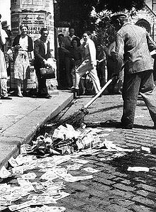 Hyperinflation in Germany, 1923- People sweeping money in the streets.