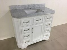 Freestanding bathroom vanity with carrara marble top porcelain sink,modern design.