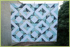 http://quiltstory.blogspot.com/2010/11/hst-quilt-tutorial-part-2.html