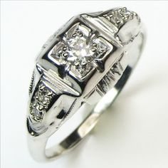 Easy Deco: Comfortable, sparkly, and filled with Art Deco goodness, this is a wonderful choice for those who want a single ring that can be the engagement ring and also the band. Ca.1940. Maloys.com