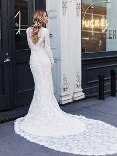 The Sienna bridal gown by @goddessbynature features french floral lace and an open back with button up detail. See more here: https://www.goddessbynature.com/shop/sienna/