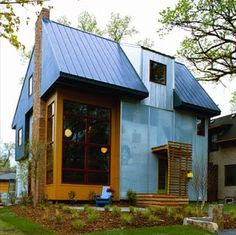 Small home designed by Locus Architecture, the exterior of this house is made from salvaged billboards and translucent polycarbonate panels. The home is just as beautiful on the inside. http://www.locusarchitecture.com/