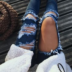 $8.22 Ripped blue jeans.