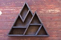 – Large Mountain Geometric Shelf –  This large abstract shelf will be sure to draw attention to any room in your home. Stand it up on any surface or hang it on your wall. Small mounting brackets make hanging this shelf a breeze.  Size - 24 (H) x 28  (W) x 3.75 (D)  MATERIALS: Premium Cedar Wood  SHIPPING: Items will be shipped within 1-2 weeks of order placement via USPS.  All images and designs are the property of WestwardGoods.com, Copyright 2015  PROUDLY MADE IN THE USA