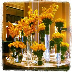 Yellow roses, orchids and tulips