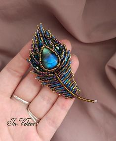 Best 12 Feather brooches by Evgenia Vasileva. Bead embroidered and fringed – Japanese seed beads, firepolished crystals, nmetal findings. Bead Embroidery Tutorial, Bead Embroidery Patterns, Bead Embroidery Jewelry, Beaded Jewelry Patterns, Hand Embroidery Designs, Beaded Embroidery, Seed Bead Jewelry, Bead Jewellery, Seed Beads