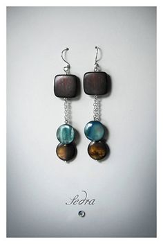 wood and shell teal and brown dangle earrings by JewelrybySedra, $29.00 http://www.facebook.com/pages/Jewelry-by-Sedra/362826423729836