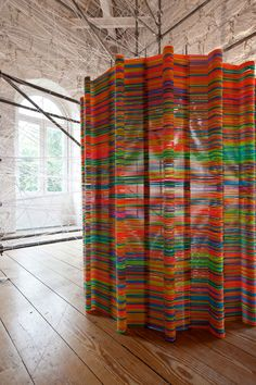 plastic hangers! likearchitects: chromatic screen installation