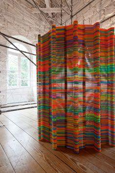 plastic hangers! likearchitects: chromatic screen installation