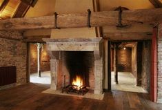 Large beams and a rip roaring fire Rustic Design, Rustic Style, Modern Rustic, Wooden Fireplace Surround, Fireplace Design, Rustic Fireplaces, Fireplace Mantels, Rustic Interiors, Cabin Interiors
