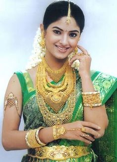 Actress Meera Chopra in Traditional South Indian Bridal Jewellery - love the gren sari and beautiful gold belt, nice to see that style charming.