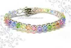 Swarovski Crystal Bracelet - Sweet rainbow single row bracelet by CandyBead via Etsy Bracelet Swarovski, Swarovski Jewelry, Crystal Bracelets, Crystal Jewelry, Swarovski Crystals, Silver Jewelry, Beaded Bracelet Patterns, Schmuck Design, Jewelry Design