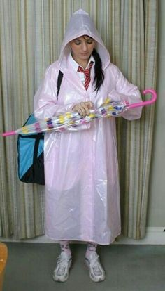 Off to school.in her pink pvc mackintosh