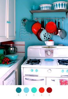 beautiful colorful . I'm a big fan of robin's egg blue/teal in kitchens. Red and teal is a very classic color combo. This one's got a good punch of modern to it. Note white cabinets, punchy wall color.
