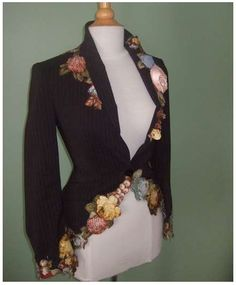 love how the hem follows the floral applique