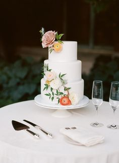 A classic white wedding cake with pastel florals, perfect for a garden wedding day!
