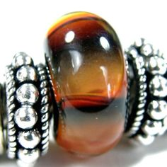 Black And Orange Fade Handmade Large Hole Lampwork Bracelet Charm Bead              This bead turned out really cool to look at.  I made this glass bead on a base of black @covergirlbeads