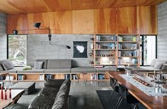 Test Out Tiny House Living at One of These Nature-Immersed Cabin Resorts modern sea ranch coastal living dining area douglas fir black walnut dining table Serge Mouille Lamp, U Couch, Concrete Interiors, Sea Ranch, Interior Architecture, Interior Design, Walnut Dining Table, Built In Seating, Extra Seating