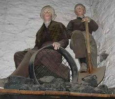 Display at the Yorkshire Mining Museum showing two female miners sorting coal
