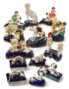 A GROUP OF THIRTEEN STAFFORDSHIRE PORCELAIN FIGURES AND GROUPS OF DOGS 19TH CENTURY - Sotheby's (Brooke Astor estate)