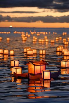 "TORO-NAGASHI IN HAWAII, TO REMEMBER. LANTERN OFFERINGS ON THE WATER... Candle-lit lanterns are launched from the beach to honor those who have perished that year and to pay respect to their ancestors. A Buddhist rite, originally from Japan to carry spirits ""from the sea of delusion to the shore of salvation."" Thousands here in Hawaii take part every year to remember those close to them."