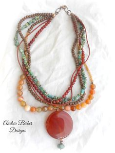 Orange. Stone, wood, glass, seed beads, large chunky necklace.