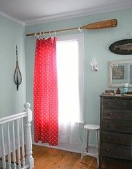 Canoe paddle as curtain rod.  In guest room