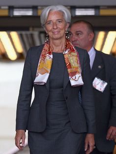 Christine Lagarde, Managing Director of the International Monetary Fund is perfectly dressed in a feminine professional dress suit.  She looks GREAT!
