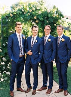 In love with this wedding day look that includes blue suits and floral ties for the men.