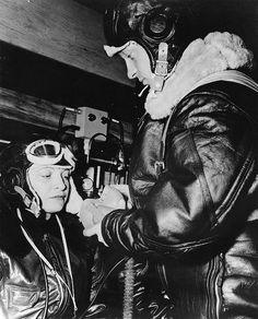 US Navy sailor helping a WAVES trainee putting on her oxygen mask, Naval Air Station, Jacksonville, Florida, 15 Oct 1943 (US National Archives)