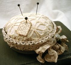 pincushion made out of old canning jar lid
