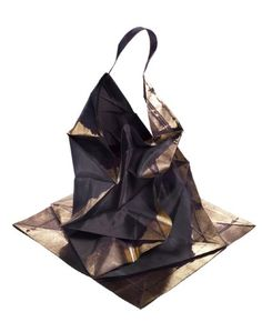 Miyake dress, presented as flat, geometrical shapes, made from recycled plastic bottles