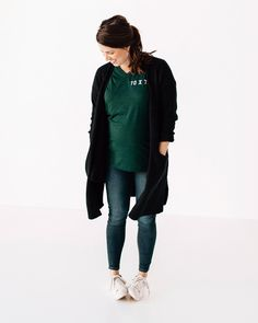 Brooke is loving our embroidered tees! She's styled this 70 X 7 Embroidered Emerald V-Neck with some skinny jeans and a long-line black cardigan. Minimal accessories, and some casual white sneakers, and she's ready for a day of working and running around after a 2 year old!
