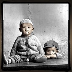 Ahida (10months) and Sonam (21months),  Muslim children who live near their mosque in Lhasa, the capital city of Tibet.