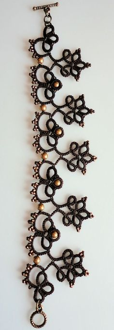 this is an interesting tatted piece ... sort of antique but could be layered with other pieces to make it more boho.