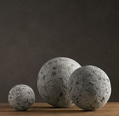 Restoration Hardware concrete spheres  Lava Stone Spheres are speckled and no two stones are alike. They range in size and price, from 5 inches ($31) to 11.5 inches ($80), at Restoration Hardware.