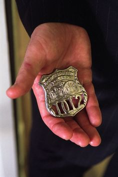 Remembering September 11 Photo: President George W. Bush holds the badge of George Howard, a police officer killed in the September 11 attacks.   On September 20, 2001, President George W. Bush addressed a Joint Session of Congress.  Toward the end of his speech, the president held up the NYPD silver badge and said,