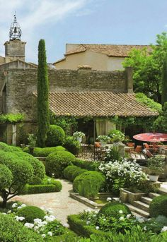 Beautiful elegant garden. Green shrubs make it lush, while pots of flowers add color. Remember...the more flowers, the more labor intensive.