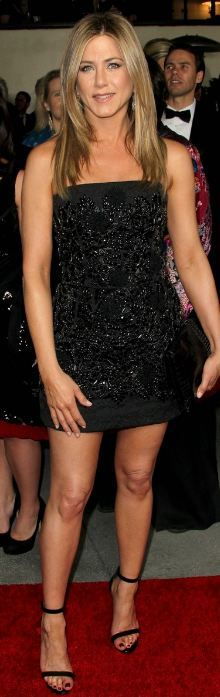 Who made Jennifer Aniston's black strapless beaded dress, sandals, and clutch handbag that she wore in Hollywood on January 28, 2012?