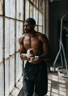 Male boxer putting a strap on his hand | premium image by rawpixel.com / Felix Jump Rope Training, Boxer Training, Thai Boxer, Red Boxing Gloves, Female Boxers, Gorgeous Black Men, Image Fun, Muscular Men