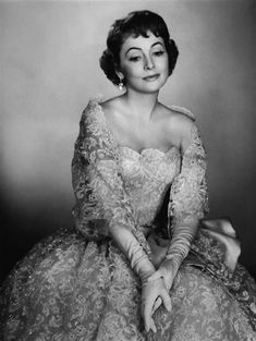 Olivia de Havilland wearing a gown by Christian Dior, 1955. Photo by Raymond Voinquel.