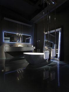 furniture in concrete black. LED mirror. Cristalplant bathtub covered with black cement.