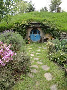 Round blue door in underground hobbit house.