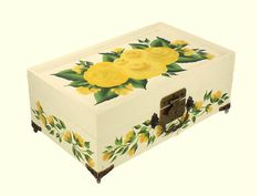 A fresh, cheerful design of deep yellow gold roses on the top, and vines of gold rose buds surround the front and sides. Includes free