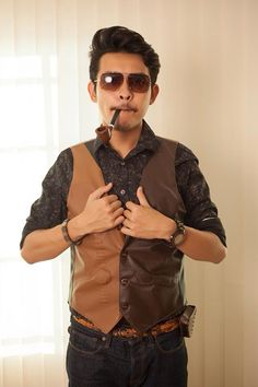 Dandy Black Floral Shirt with brown leather waistcoat sun glasses and some wood accessory #dandy #menfashion #fashion #style
