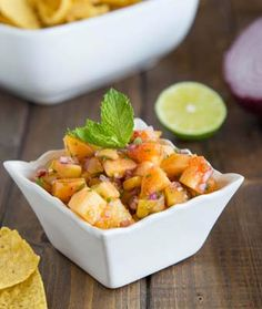 Peach Salsa-Quick and easy, this Peach Salsa brings a burst of summer to the table. Use as a dip or spoon over grilled chicken or fish. Lime juice, mint and cilantro give sweet peaches a kick and taste great with chips. The perfect party food - serve this on Memorial Day weekend or at a 4th of July picnic. This condiment will have your guests double dipping!