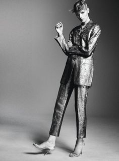 Photographed in black and white, Esther Heesch wears metallic jacket and pants